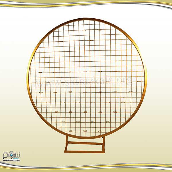 تصویر بک دایره ای فلزی طلایی تمام توری
